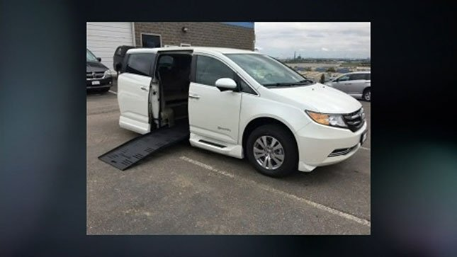 """Photo of a van similar to Holmes' van, which is described as a white 2012 Honda Odyssey with a ramp and a sticker in the back that says """"Performance Mobility""""."""