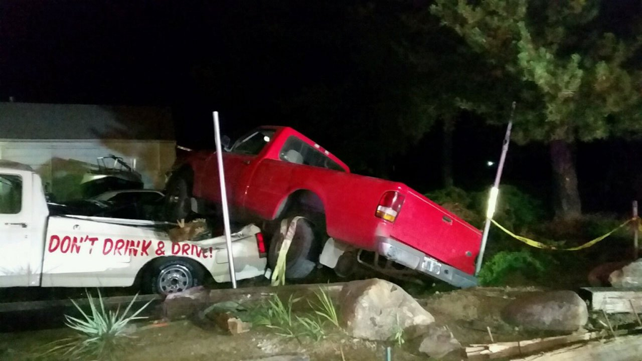 "Scene where a driver in Salem missed a turn early Saturday morning, running through a fence and hitting a truck with the phrase ""Don't Drink & Drive"" painted on it. The driver faces DUII charges. (Photo: Denis Lafferty)"