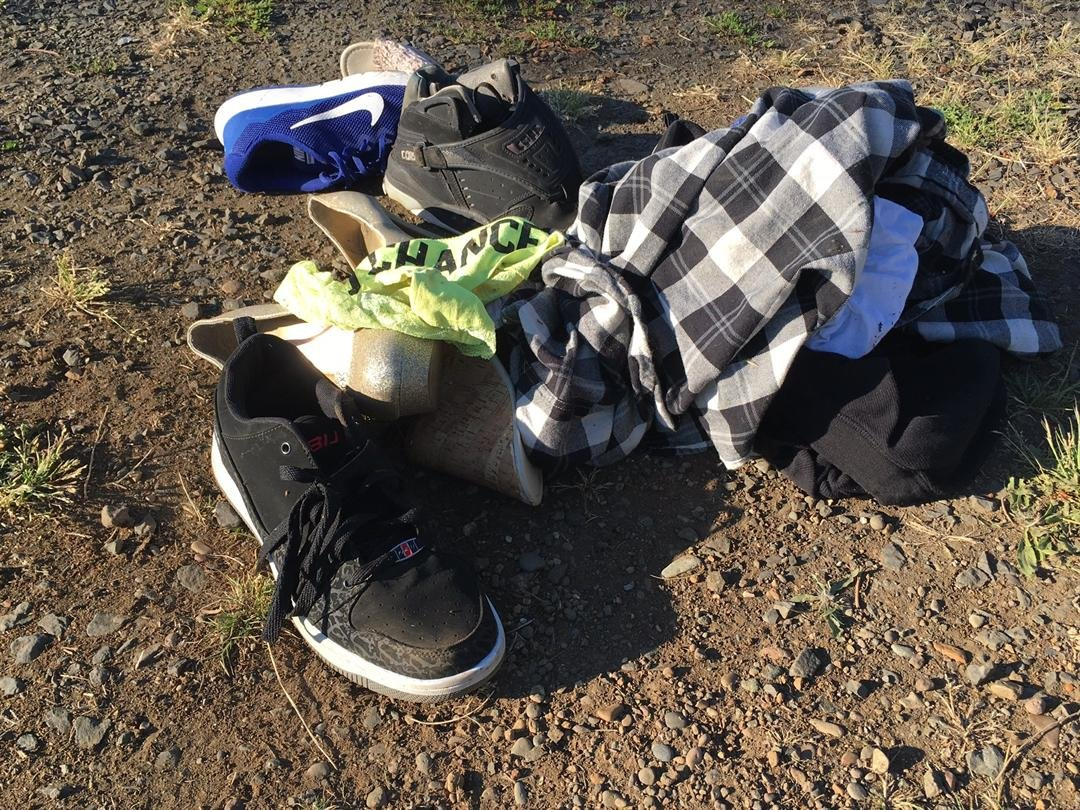 A pile of clothes and shoes belonging to the suspects, recovered in the stolen truck Tuesday. (KPTV)