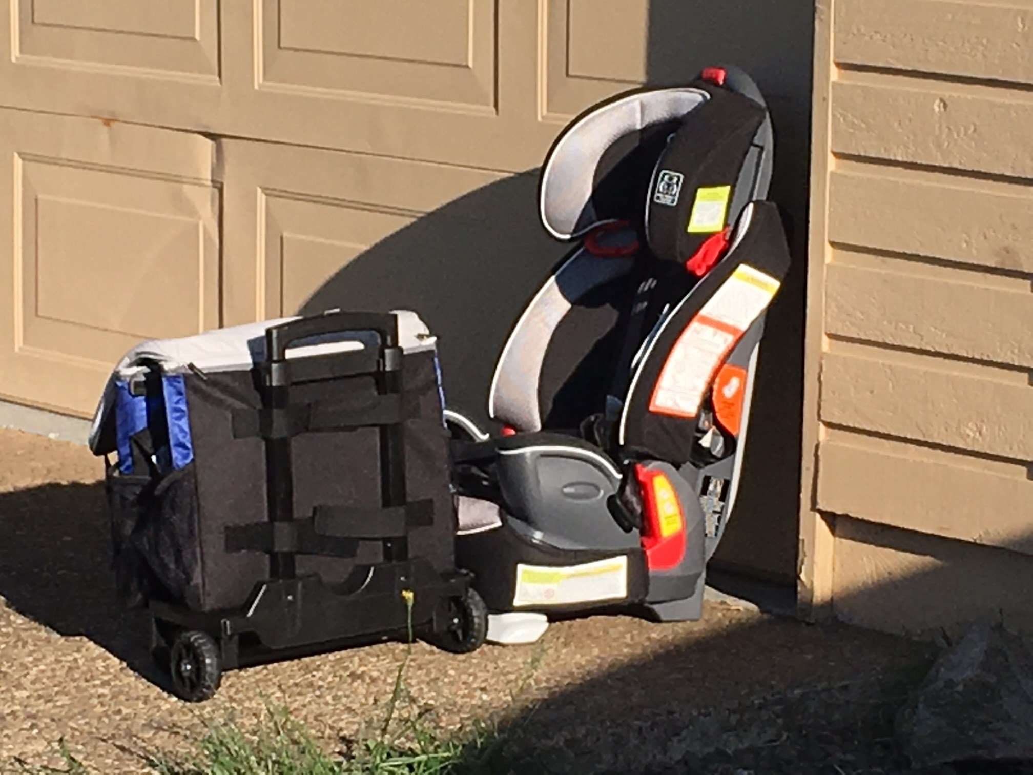 A carseat and cooler bag on wheels: the only stolen items recovered in the stolen truck Tuesday. (KPTV)