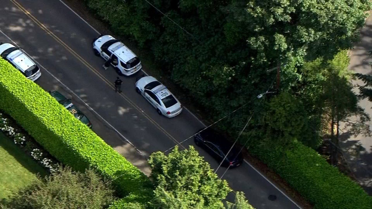 Law enforcement at the scene of a reported burglary and shooting in SW Portland. (KPTV/Air 12)