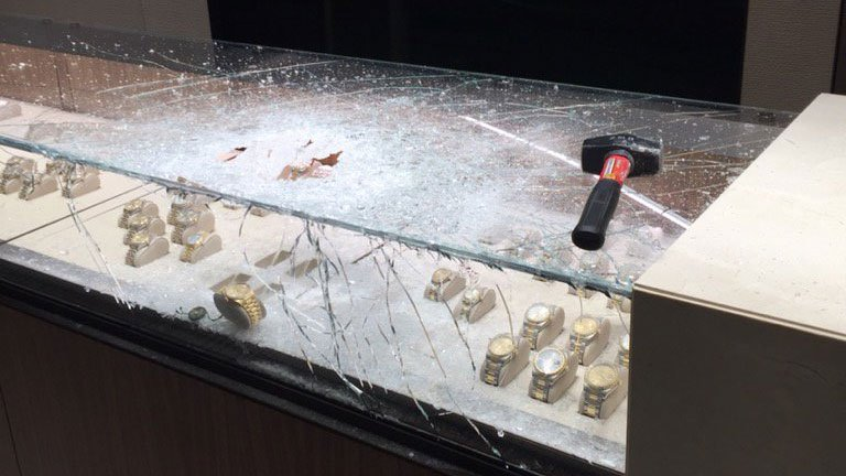 Witnesses said they saw the suspect enter the jewelry story and without a word go up to the display case and smash it with a sledge hammer, taking three watches valued at $100,000. (Tigard PD)
