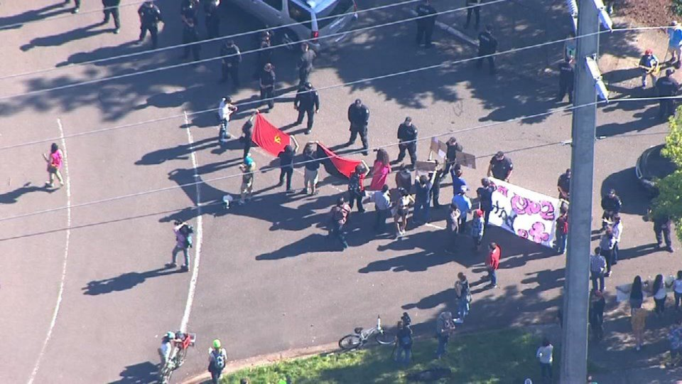 Protesters lined up outside the Lane Events Center for a Donald Trump rally last month. (Source: KPTV)