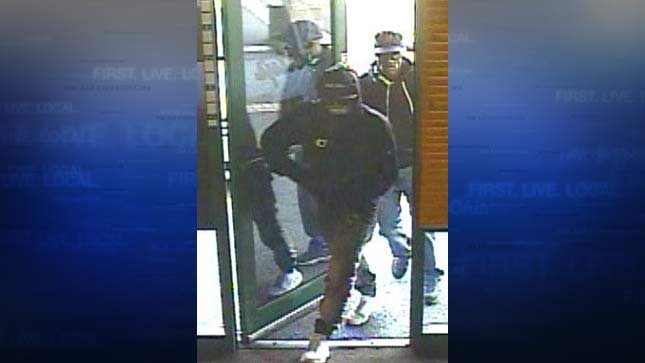 Surveillance image of armed robbers at Dotty's Deli in Tigard. (Photo: Tigard PD)