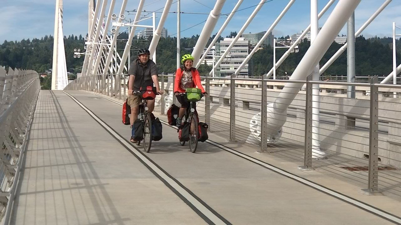 Gustav Erlank and Susanne Holste beginning their 4,000 mile journey on the Tilikum Crossing. (KPTV)
