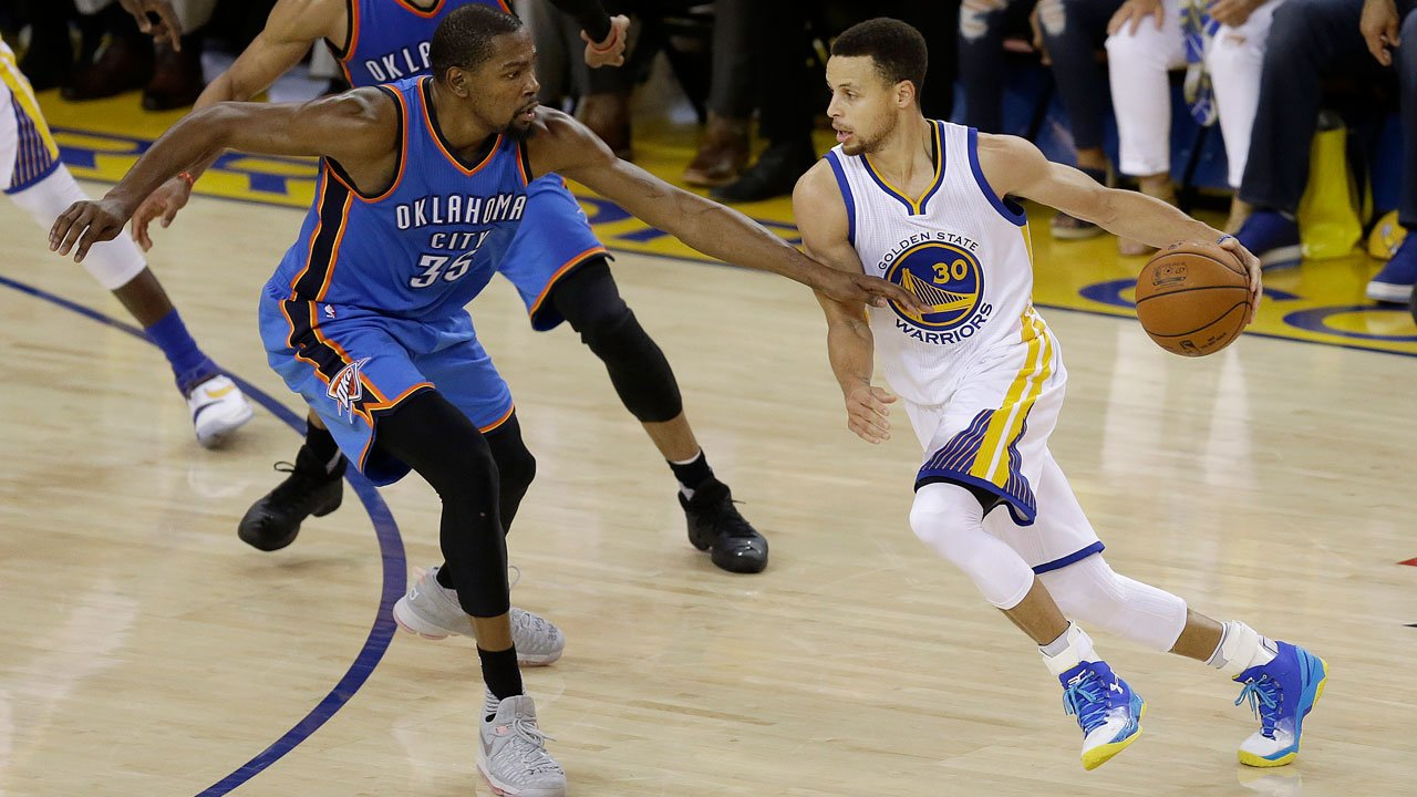 Golden State Warriors guard Stephen Curry dribbles against Oklahoma City Thunder forward Kevin Durant during the first half of Game 7 of the NBA basketball Western Conference finals in Oakland, Calif., Monday, May 30, 2016. (AP Photo/Ben Margot)