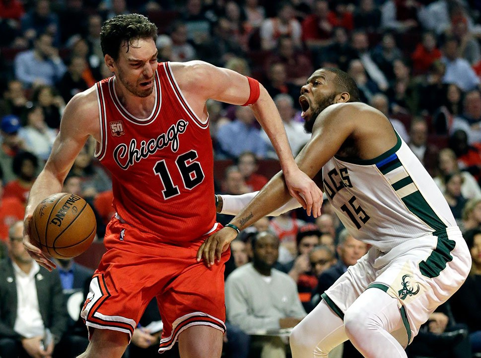 Chicago Bulls center Pau Gasol, left, drives against Milwaukee Bucks center Greg Monroe during the second half of an NBA basketball game Monday, March 7, 2016, in Chicago. (AP Photo/Nam Y. Huh)