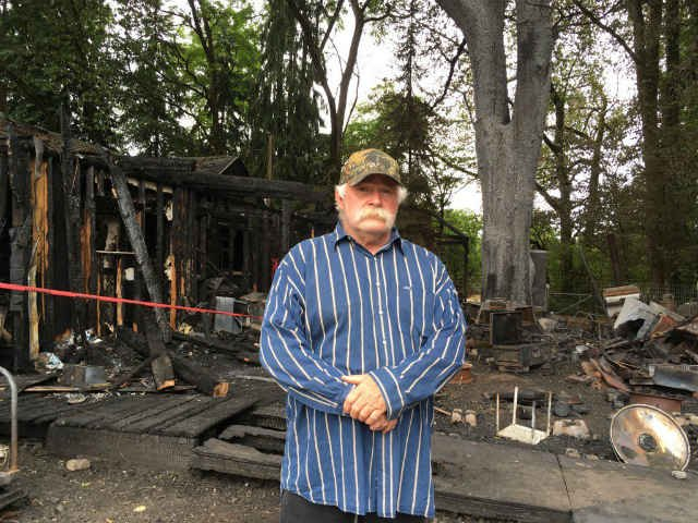Larry Hailey in front of what is left of his home after a fire tore through it last Thursday morning. (KPTV)