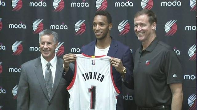 General manager Neil Olshey, Evan Turner and coach Terry Stotts. (Photo: KPTV)