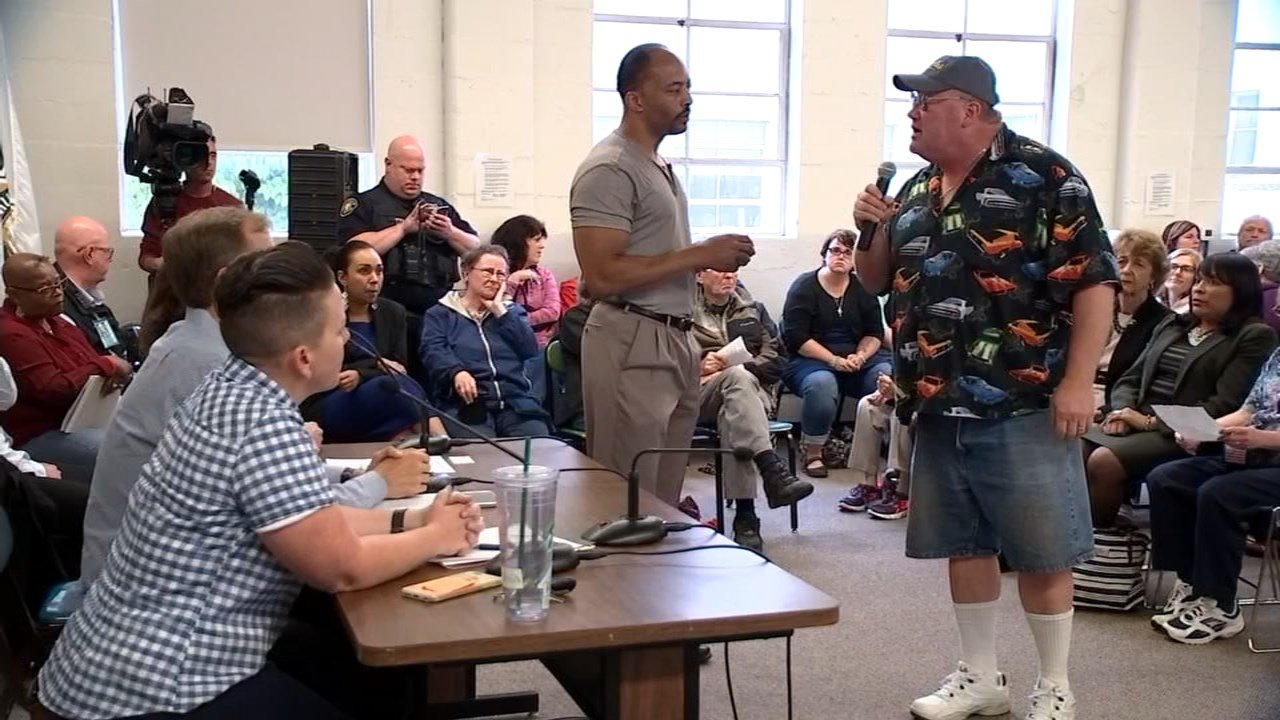 Concerned resident talking in front of a community meeting about a new 24-hour homeless shelter.(KPTV)