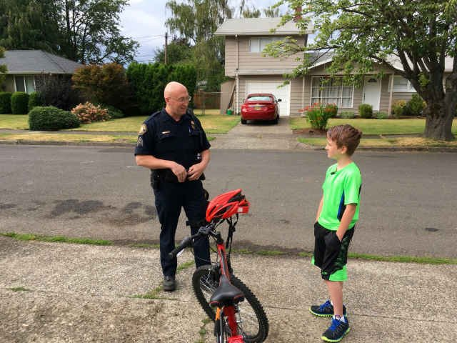 Sgt. Bren with Miles and his new bike. (KPTV)