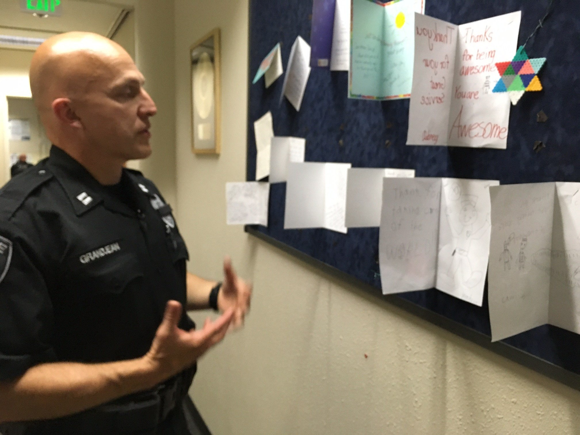 Capt. Claudio Grandjean next to a dozen notes of encouragement and support Tuesday. (KPTV)