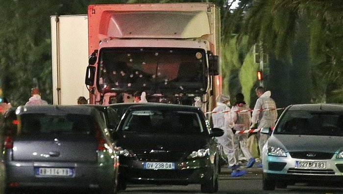 The truck which slammed into revelers late Thursday, July 14, is seen near the site of an attack in the French resort city of Nice, southern France, Friday, July 15, 2016. (AP Photo/Luca Bruno)