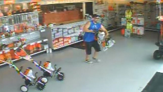 Surveillance video shows suspect stealing chainsaws from State Street Saw Shop.