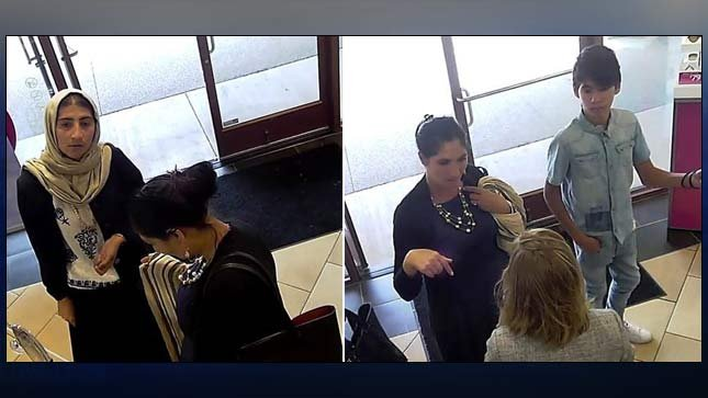 Suspects wanted in connection to theft of $6,000 in sunglasses from Sunglass Hut at Woodburn Premium Outlets. (Surveillance images released by Woodburn PD)