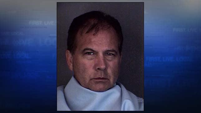 Murder suspect John Reed, jail booking photo