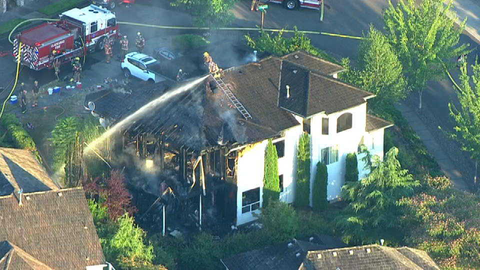 Air 12 over house fire in Clackamas