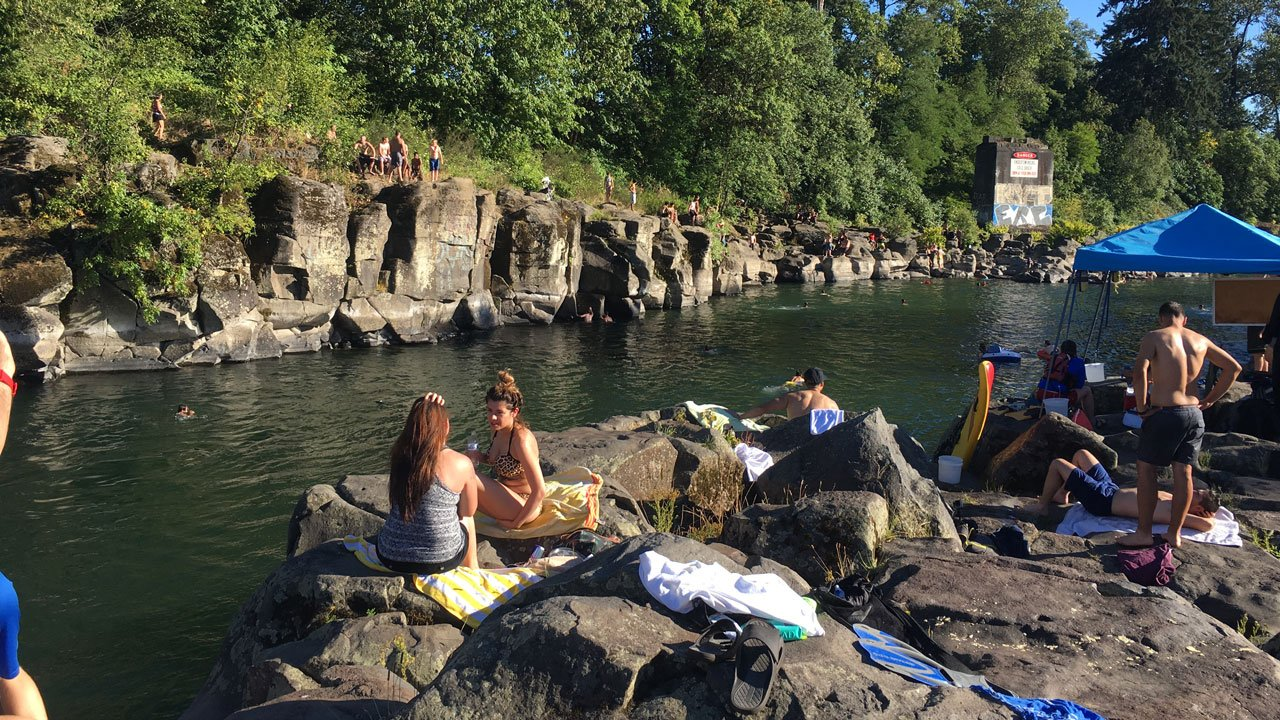 Crowds flocked to High Rocks in an attempt to be the hot weather Friday in Portland. (KPTV)
