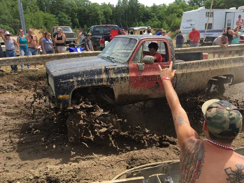 """The organizer of the """"Redneck Olympics"""" in Maine now calls the event the """"Redneck Blank"""" after Olympic officials complained about the name. (AP Photo/David Sharp)"""