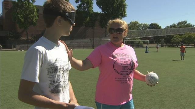 "Counselors at Camp Abilities help young visually impaired athletes compete in events from swimming to ""beep ball."" (KPTV)"