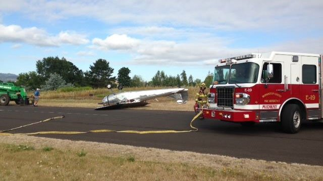 A 1952 Cessna 195 went on its top after landing at the Twin Oaks Airpark in Hillsboro Saturday. (Tualatin Valley Fire & Rescue)