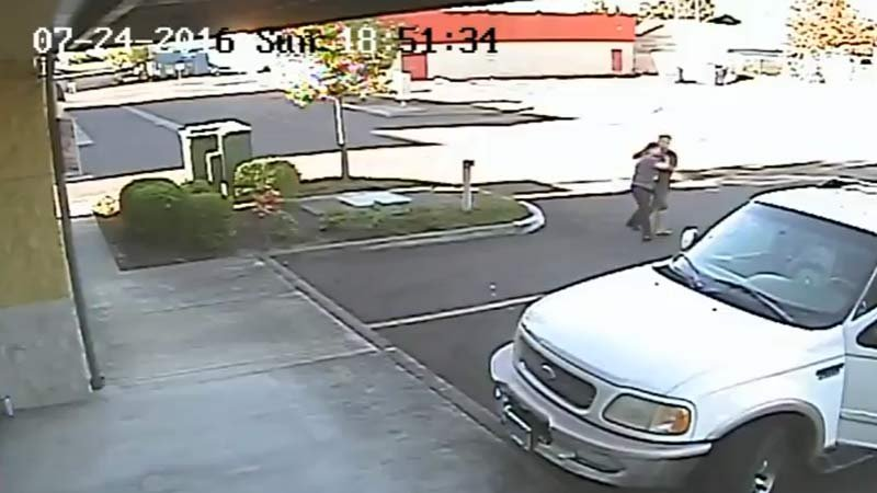 Police are seeking to ID the man and woman seen in surveillance video on the 100 block of Lancaster Drive Southeast on July 24. (Surveillance image released by Salem PD)