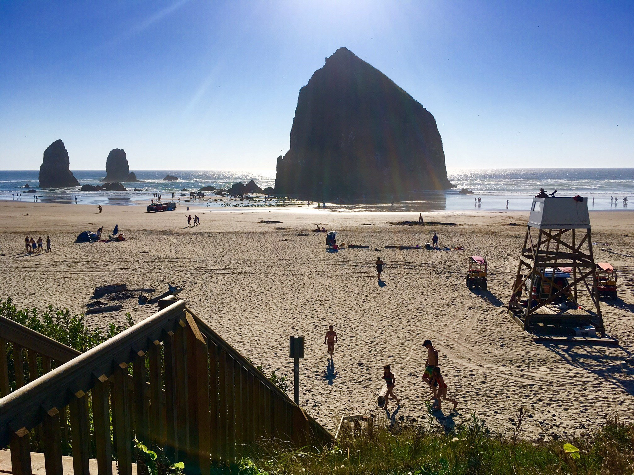 People enjoying Cannon Beach near Haystack Rock Friday.