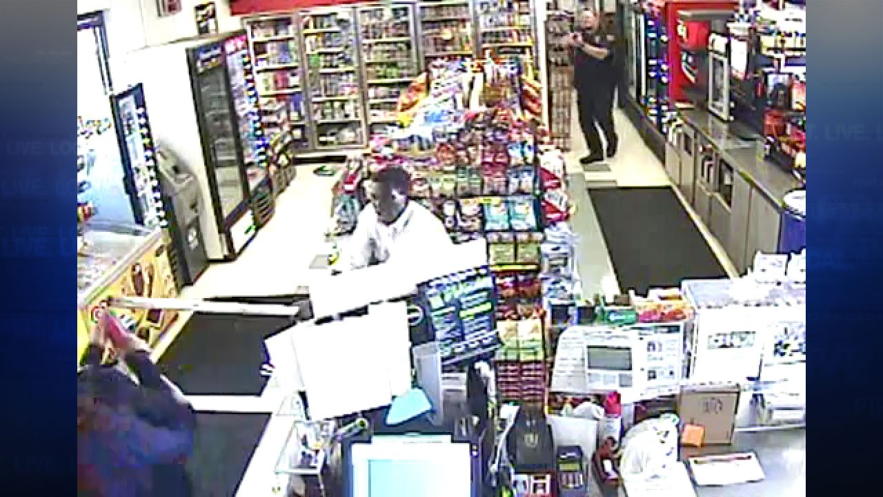 Security footage from the Flying K store in Kelso shows Omer Ali using a 4-foot-long staff to attack a clerk and customer, seconds before turning to attack a police officer. (Cowlitz Co. Sheriff's Office)