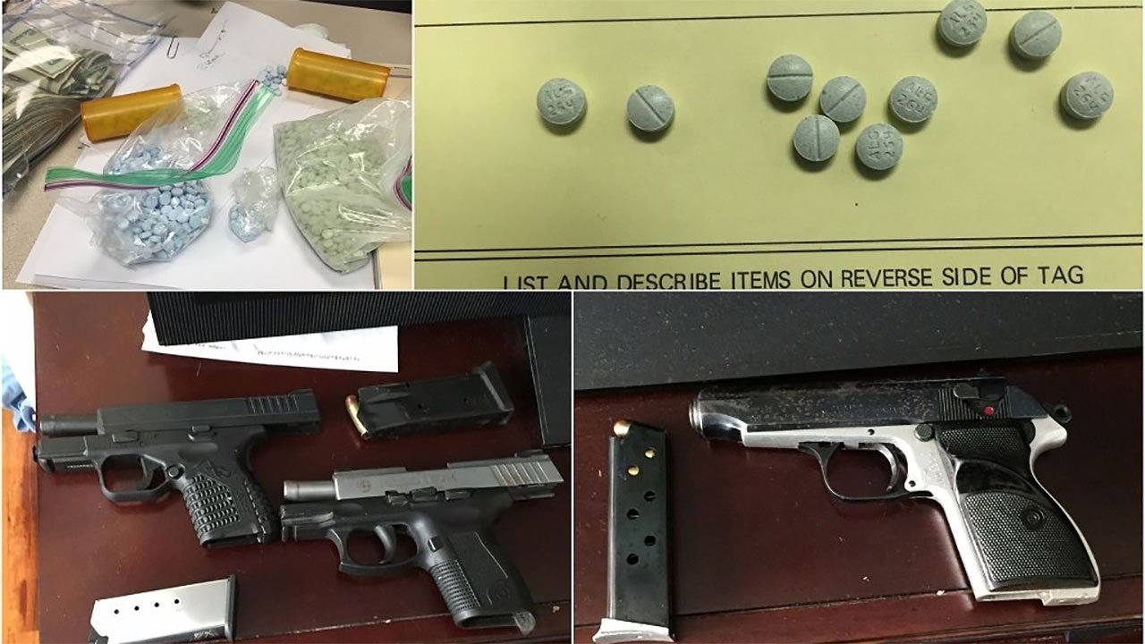 Police seized 2,000 pills thought to be counterfeit OxyContin, $10,000 in cash, a shotgun and three handguns, two of which had been reported stolen in the investigation. (Portland Police Bureau)