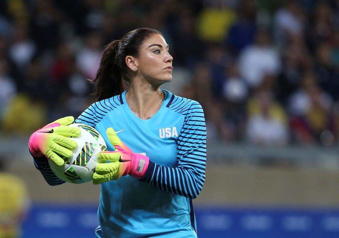 U.S. goalkeeper Hope Solo takes the ball during a women's Olympic football tournament match against New Zealand in Belo Horizonte, Brazil. (AP Photo/Eugenio Savio, File)
