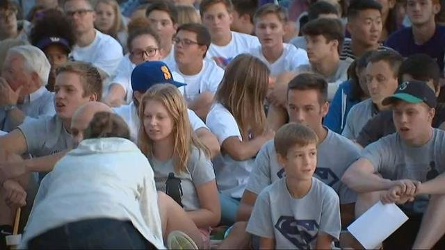 "Mourners wearing shirts saying ""I Am Sam"" and ""Sam's Army"" gathered outside Sunset HS in Beaverton Sunday to honor Sam Day, who lost his fight with cancer Saturday. (KPTV)"
