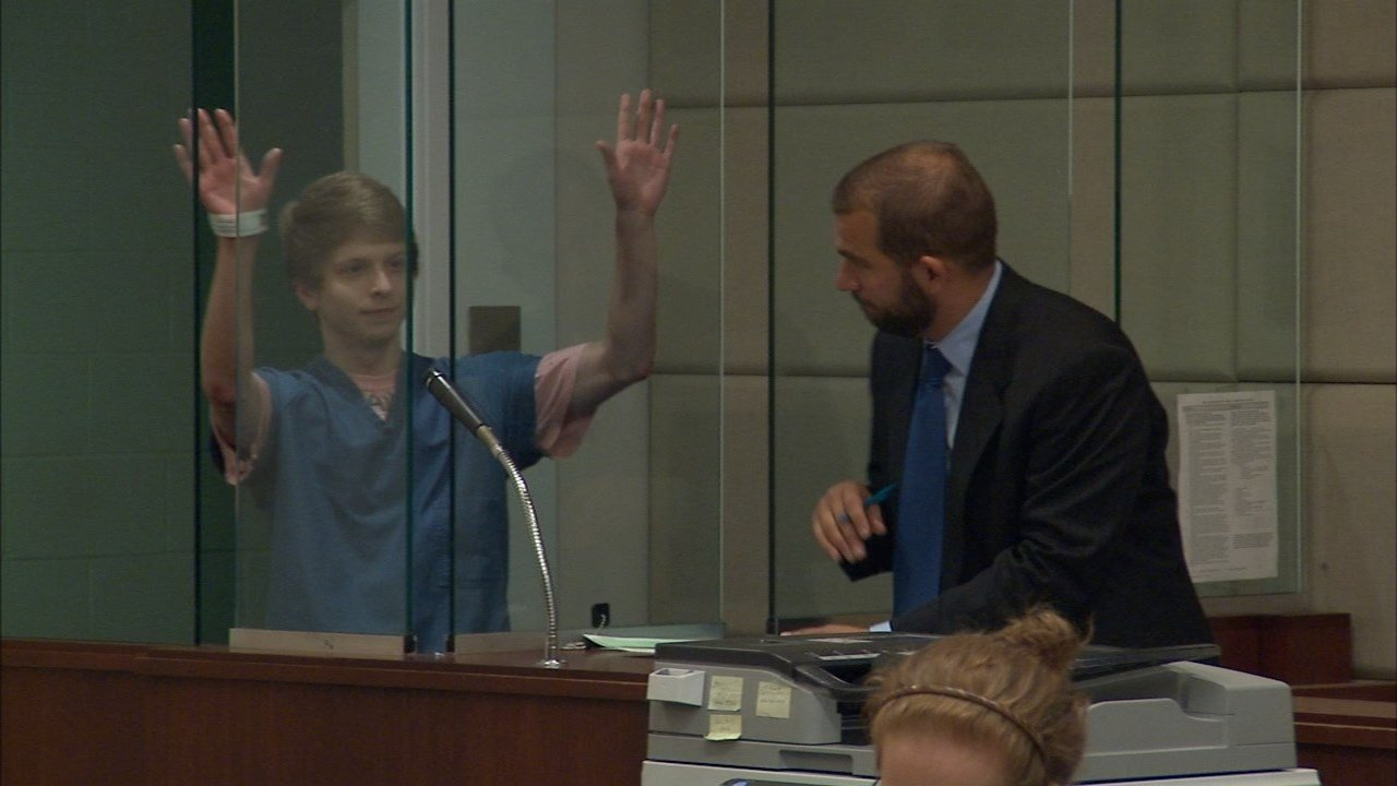 Taylor Kraig waved to supporters in court Wednesday. He is accused of murdering his girlfriend's 2-year-old son. (KPTV)