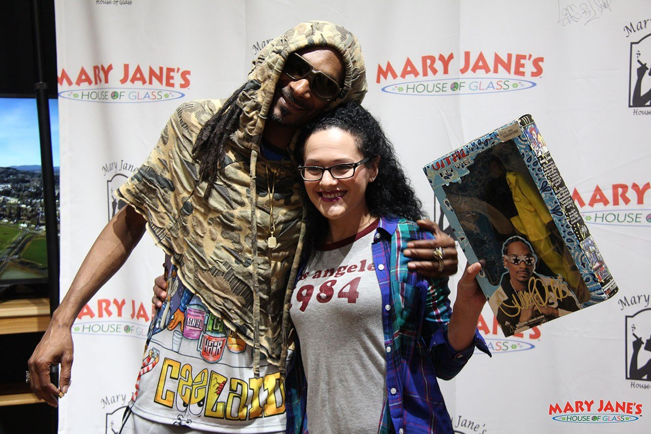 One fan that met Snoop Dogg in Portland Thursday brought a Snoop Doll, still in the box, for the rapper to sign. (Mike Emmons, Mary Jane's House of Glass)