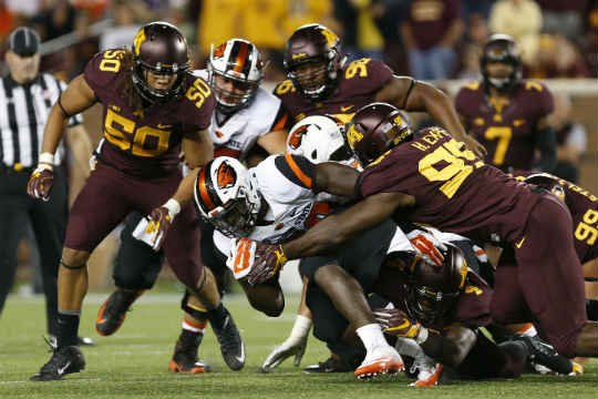 Oregon State safety Hunter Mattson drives against Minnesota defensive lineman Hendrick Ekpe, right, during an NCAA college football game Thursday, Sept. 1, 2016, in Minneapolis. Minnesota won 30-23. (AP Photo/Stacy Bengs)