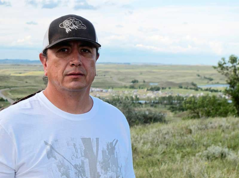 In this Aug. 26, 2016, photo, Standing Rock Sioux Chairman Dave Archambault II poses for a photo near Cannon Ball., N.D., on the Standing Rock Sioux Reservation (AP Photo/James MacPherson)