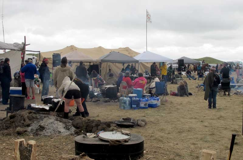 People protesting the construction on a four-state oil pipeline at a site in southern North Dakota gather at campground near the Standing Rock Sioux reservation on Thursday, Aug. 25, 2016. (AP Photo/James MacPherson)