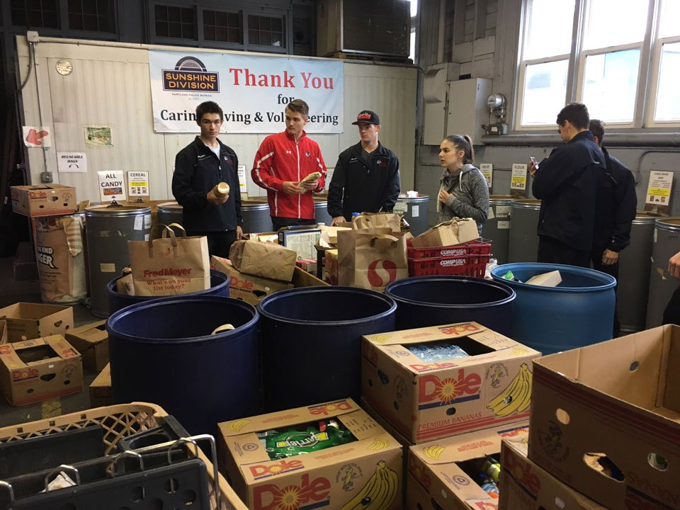Members of the Portland Winterhawks joined with the Sunshine Division to pack emergency food boxes for families in need Wednesday morning. (KPTV)