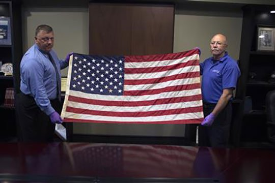 After a two-year investigation, the Everett Police Department has determined that a flag dropped off at a local fire station was flown over the site of the attacks on the World Trade Center on September 11, 2001. (courtesy city of Everett)