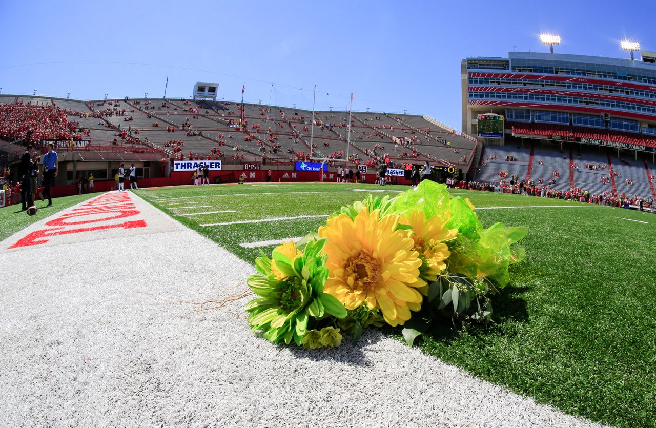 Flowers are placed at the 27-yard line by the visiting Oregon team in memory of Nebraska punter Sam Foltz (27), who was killed in a car crash last summer, before the teams met in Lincoln, Neb., Saturday, Sept. 17, 2016. (AP Photo/Nati Harnik)