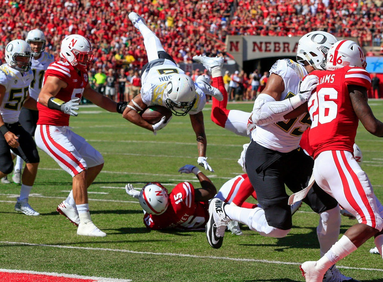 Oregon wide receiver Charles Nelson (6) leaps over Nebraska linebacker Michael Rose-Ivey (15) to score a two-point conversion during the first half of an NCAA college football game in Lincoln, Neb., Saturday, Sept. 17, 2016. (AP Photo/Nati Harnik)