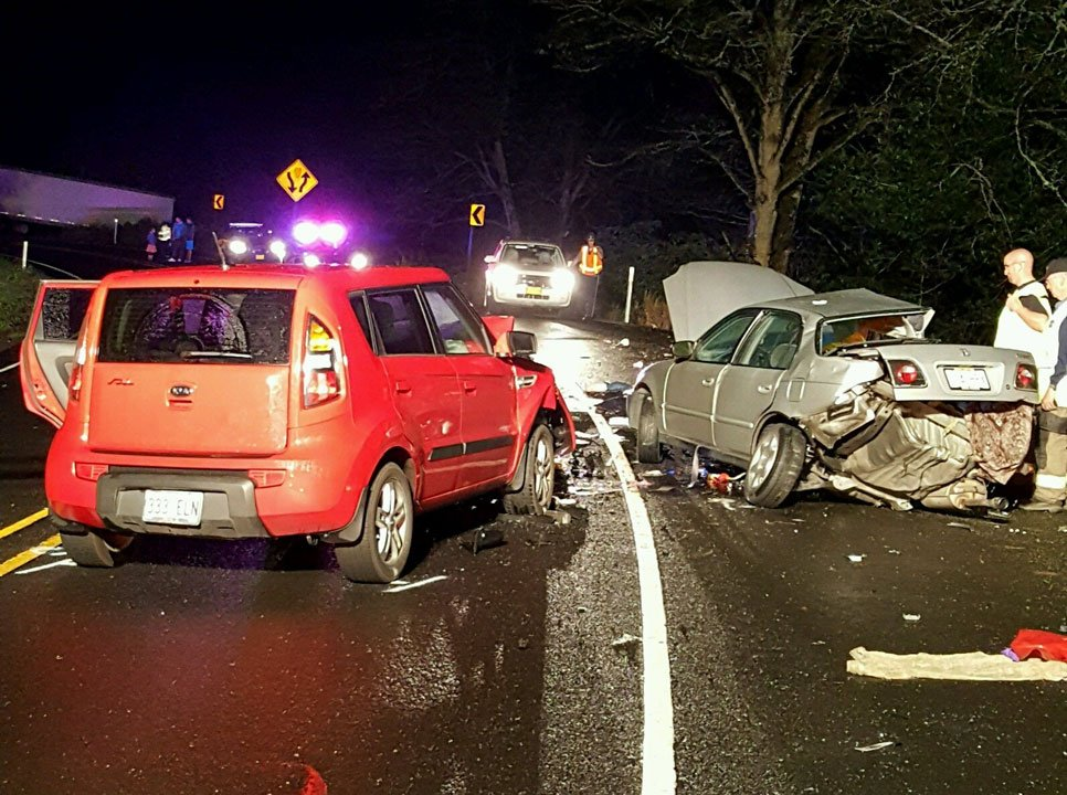 OSP troopers said two passengers in a Honda civic died after the driver lost control of the vehicle on a wet corner on Highway 18, sliding into an oncoming vehicle (Oregon State Police)