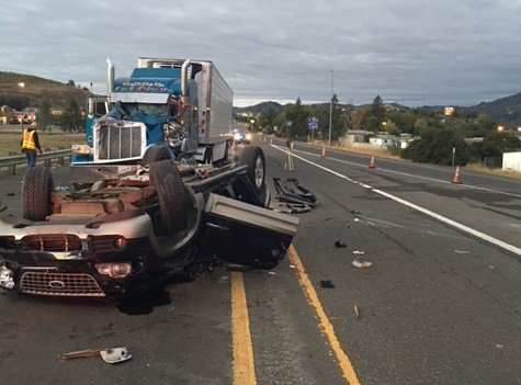 Troopers said the driver of a Ford Explorer rolled off a ramp early Sunday morning before rolling into both lanes of Highway 42, colliding with a semi-truck. (Oregon State Police)