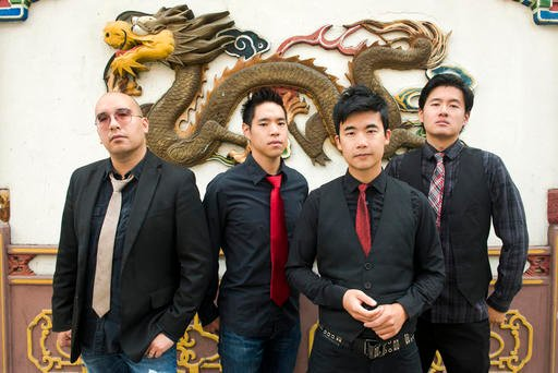 This photo provided by Anthony Pidgeon, taken Aug. 21, 2015, shows the Asian-American band The Slants. (Anthony Pidgeon/Redferns via AP)
