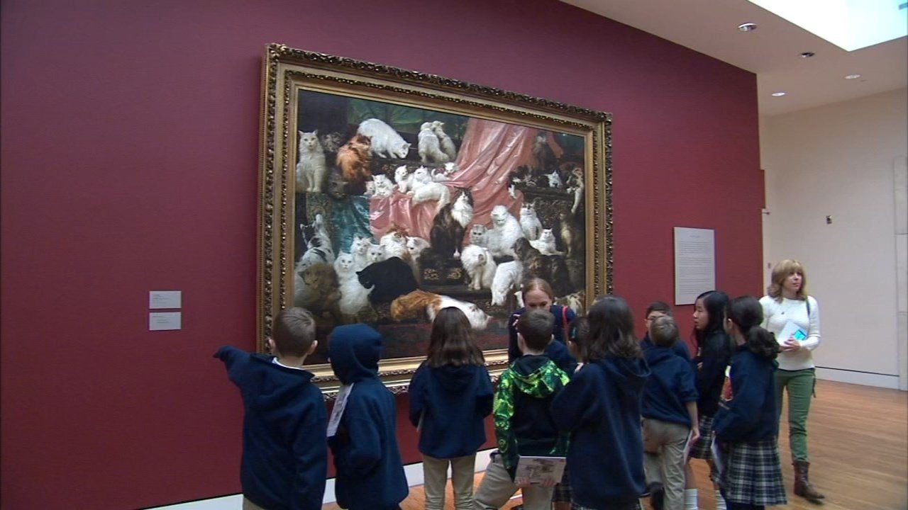Visitors to the Portland Art Museum observe 'My Wife's Lovers,' a famous painting of cats that was on display earlier this year. (File photo/KPTV)