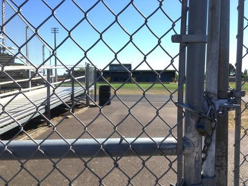 (AP Photo/Andrew Selsky). The gate is locked to Philomath High School at the entrance to the football field and track in Philomath.