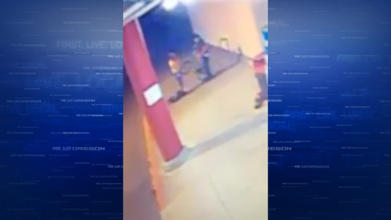 Surveillance image of confrontation between man and teen girl outside Mega Foods in Albany.