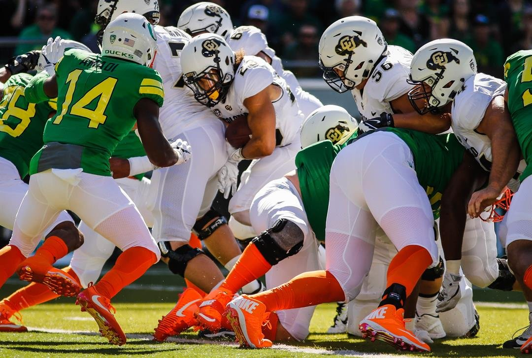 Colorado Buffaloes running back Phillip Lindsay (23), scores a touchdown in the first half against Oregon in an NCAA college football game Saturday, Sept. 24, 2016 in Eugene, Ore. (AP Photo/Thomas Boyd)