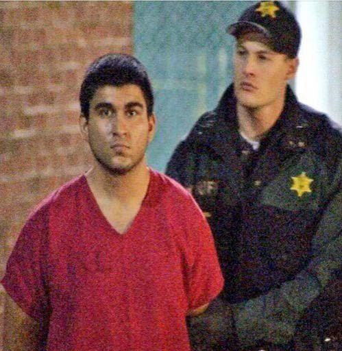 This late Saturday, Sept. 24, 2016, image from video by KIRO7 photographer Jeff Ritter shows suspected Cascade Mall shooter Arcan Cetin at Skagit County Jail in Mount Vernon, Wash. (Jeff Ritter/KIRO7.com via AP)