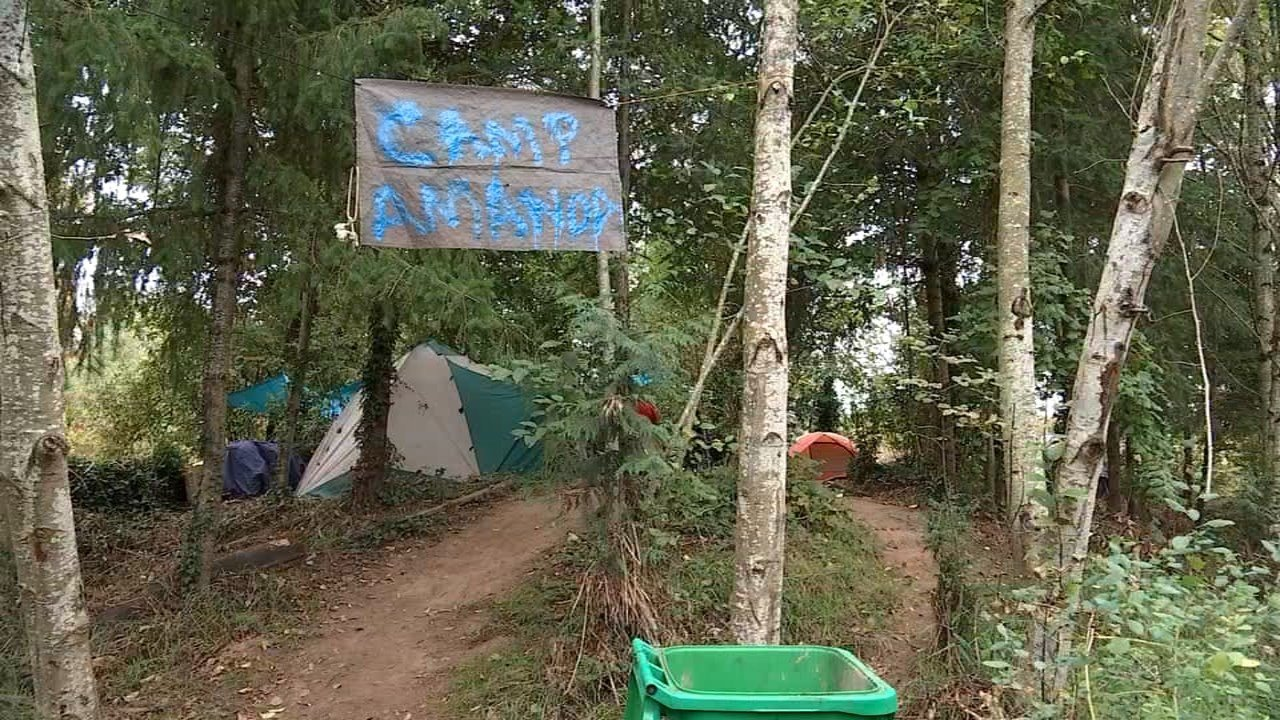 "Protesters rallied near ""Camp Amanda"" Tuesday following the posting of a notice by the city to evict the homeless encampment. (KPTV)"