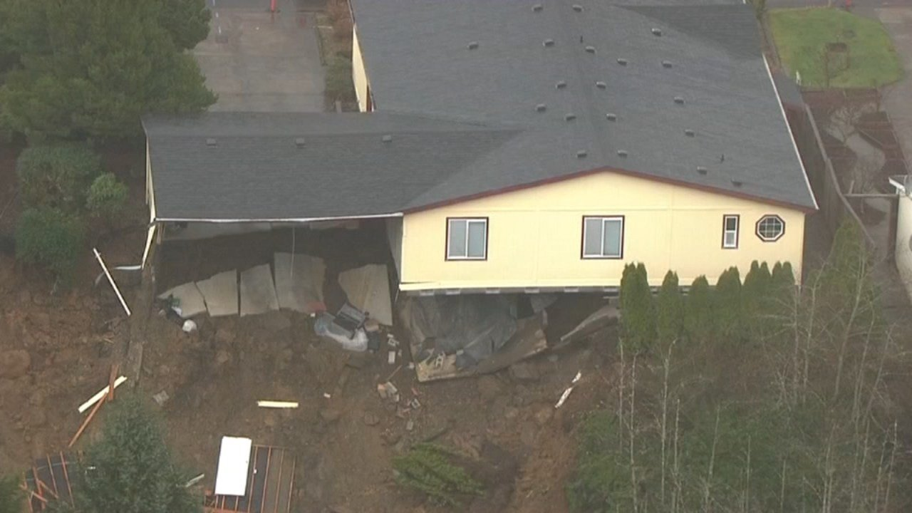 Roland Taylor is fighting to save his home following a landslide last year and a plan by Newport and FEMA to buy the properties and remove the houses. (KPTV)